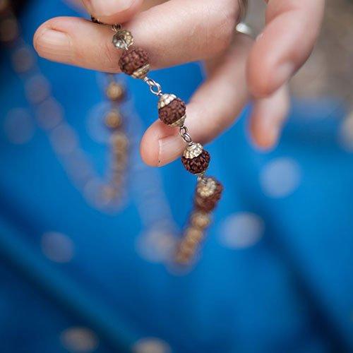Jane Craggs holding mala beads
